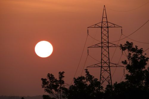 sunset electric pylon electric tower