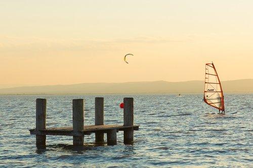 sunset  windsurfing  surfer