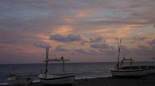 sunset  sea  boats