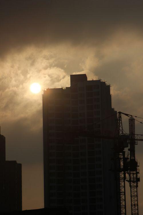 sunset tall buildings sky