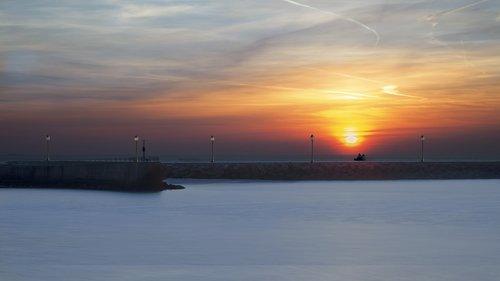 sunset  scheveningen  sea