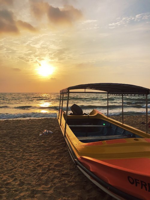 sunset  boat  beach
