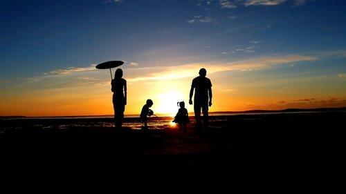 sunset  family  promenade