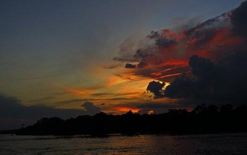sunset  river  black river