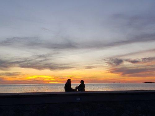 sunset  riverside  couple