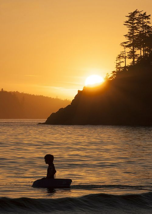 sunset silhouette surf