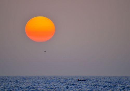 sunset fishermen sea