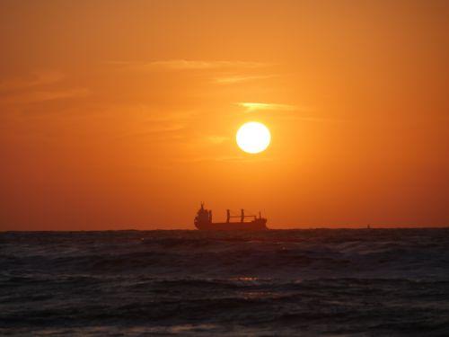 sunset boot ocean