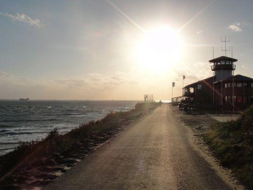 sunset pier sea