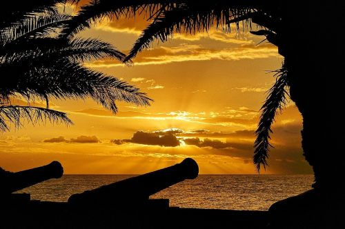sunset crepuscular rays ocean