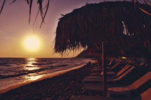 sunset beach seascape sunbeds and umbrellas seaside