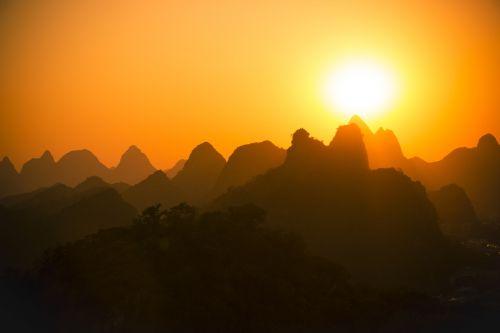 sunset mountains silhouette sunset