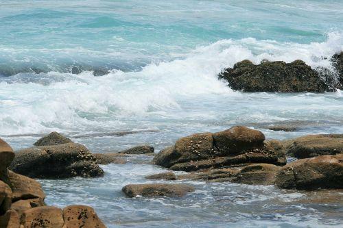 surf on rocks sea ocean