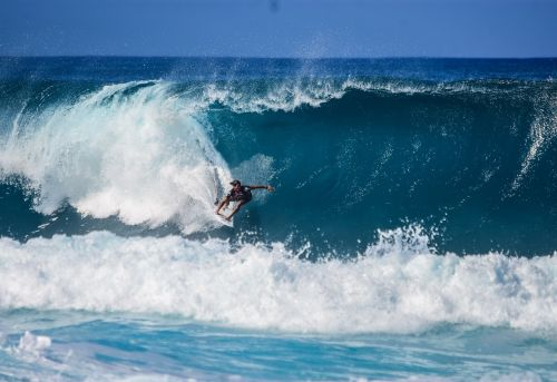 surfer surfing surfboard