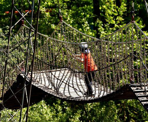 suspension bridge chains child