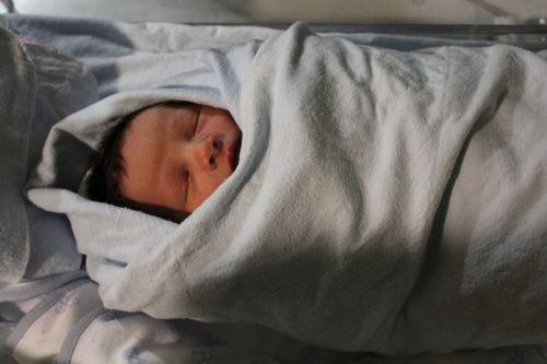 swaddled baby warm
