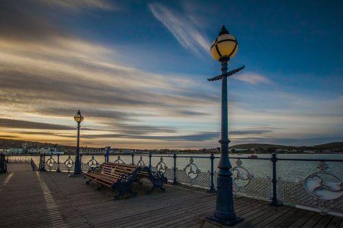 swanage bay,pier,ocean,sunset,dorset