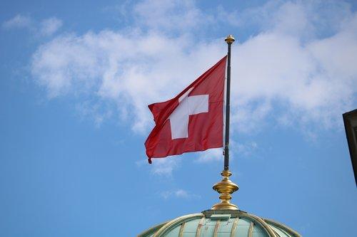 switzerland  flag  sky