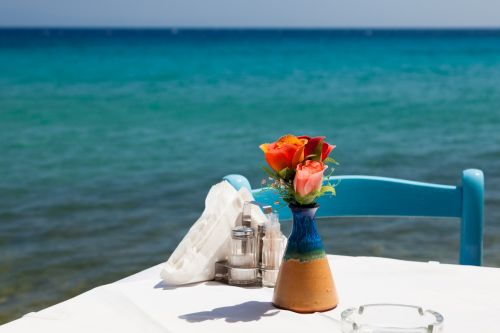 Table With Flowers And Sea