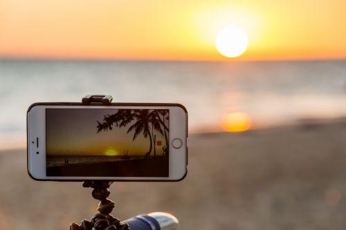 Taking Photo Of Sunset