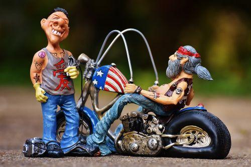 tattoo artist figures biker