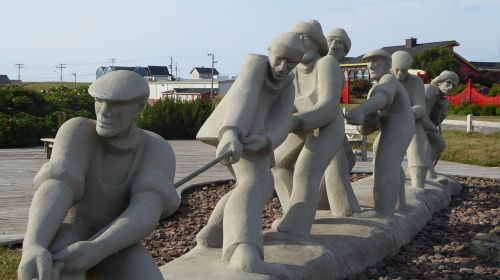 teamwork statue group