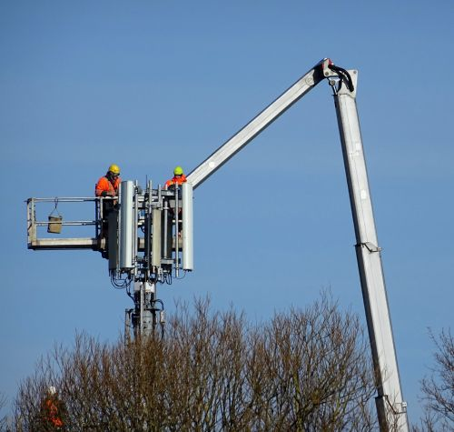 Technical Workers On Cherry Picker