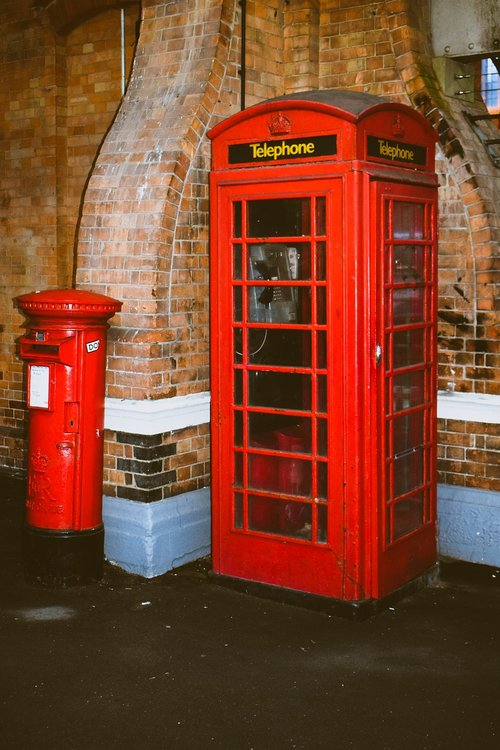 telephone booth  post box  red