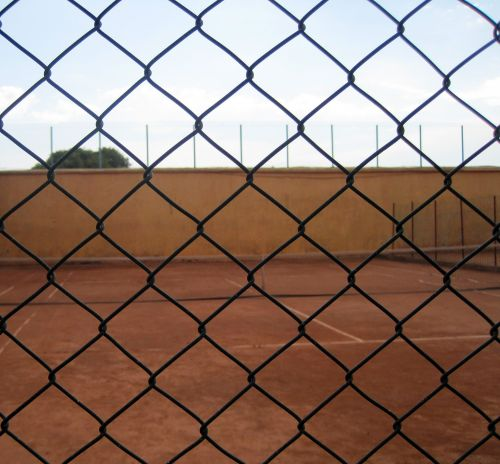 Tennis Court Through Fence