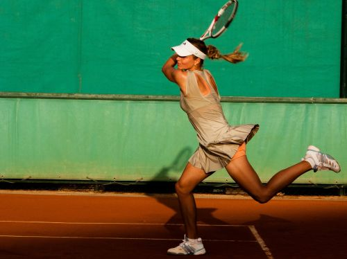 Tennis Player Returns Serve