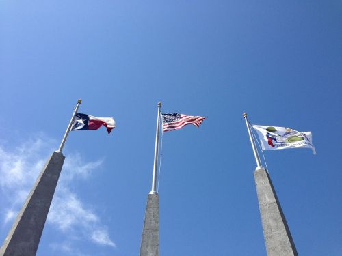 texas flag american flag blue sky