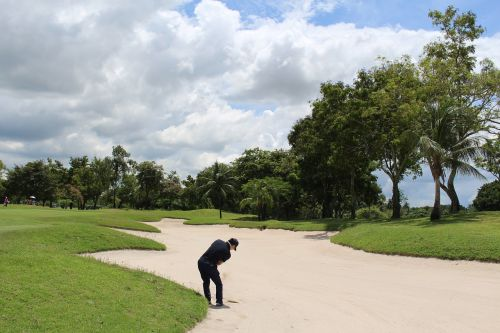 thailand golf golfer sand trap