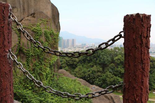 the chains railing stone pillars