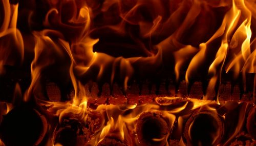 the flames burning wood