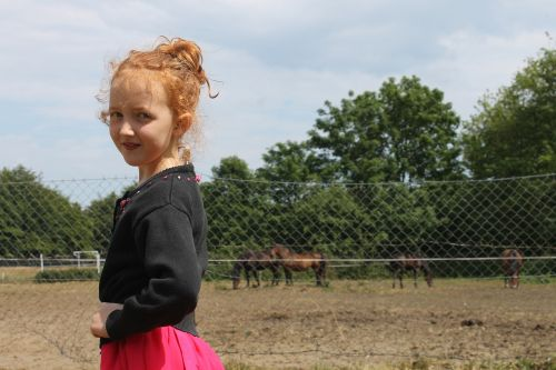 the little girl horses a smile