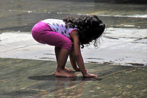 the little girl  child  wet