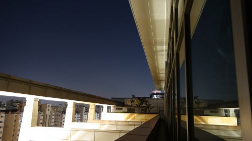 the night sky the rooftop reflections