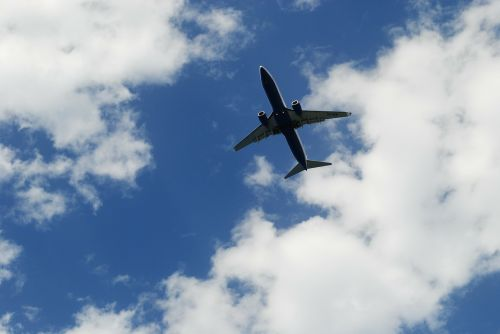 the plane clouds sky