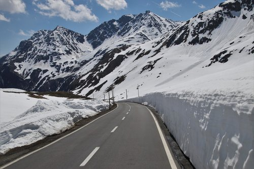 the side of the road  snow  mountains