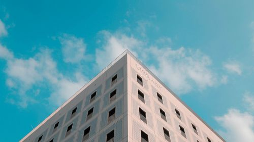 the triangular composition building blue sky and white clouds