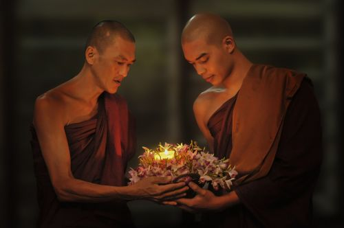 theravada buddhism monks passing candle