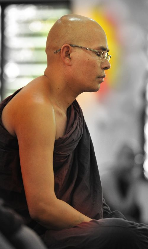 theravada buddhism monk meditating meditating