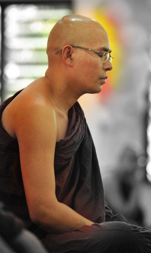 theravada buddhism monk meditating meditating