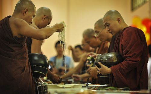 theravada buddhism sangha taking alms food monks having lunch