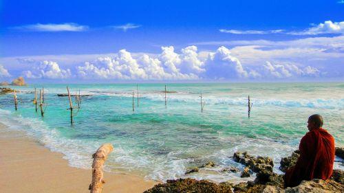 theravada buddhism monk beside beach seaside