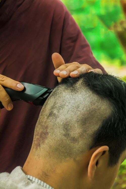 theravada buddhism shaving hair ordination