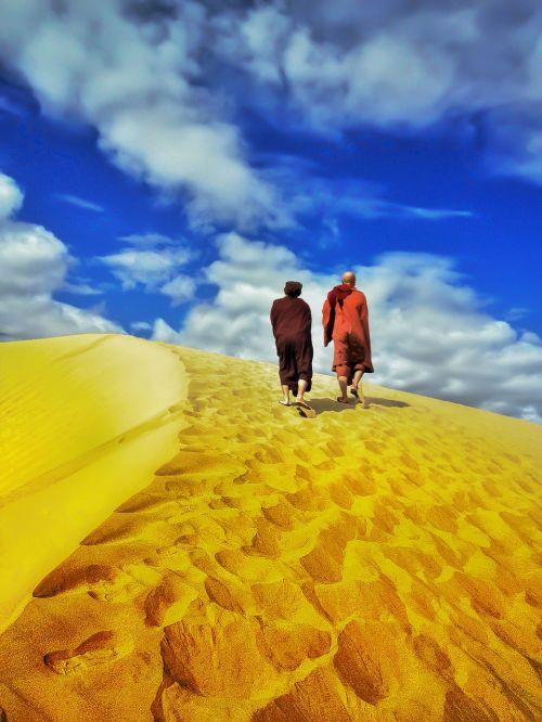 theravada buddhism monk in desert walking in dessert