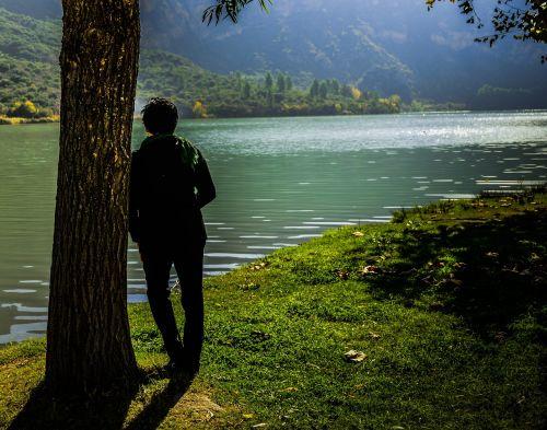 thoughtful person lake nature