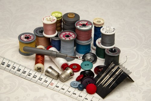 thread  needle  buttons
