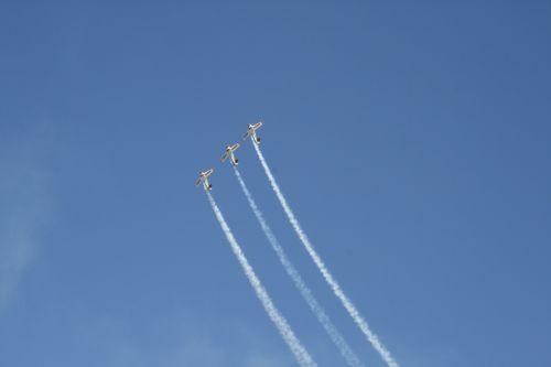 Three Harvards Leaving Jet Trails